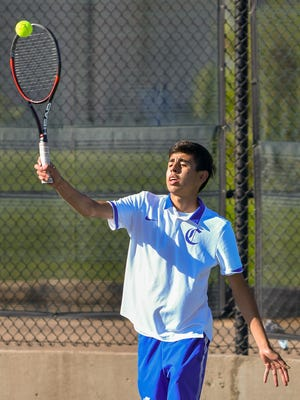 Pueblo Central's Christian Guzman returns a shot against Pueblo Centennial's Zander Pacheco on Saturday, Sept. 12, 2020, on Central's home courts. Guzman is the top seed in No. 1 singles at the Region 7 tournament.
