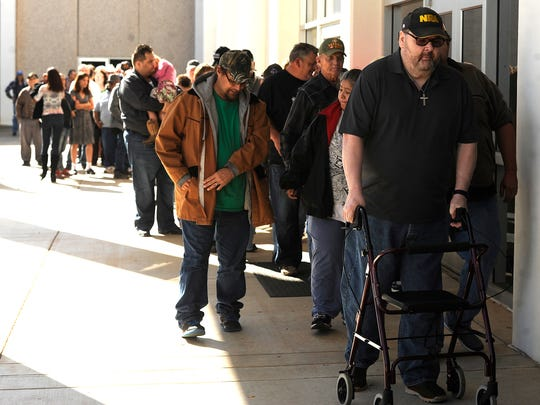 People line up before the opening of the Veterans Service Office's Operation Thanksgiving meal on Thursday, Nov. 24, 2016, at the Abilene Civic Center.