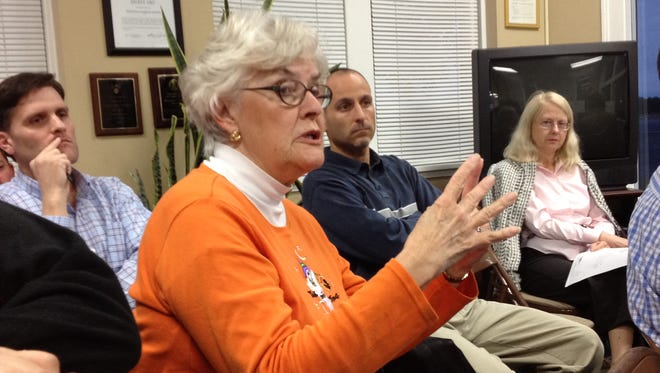 Mary Huhta, a former member of the Murfreesboro City Council, questions the city's airport runway expansion plans during a neighborhood meeting at Murfreesboro Municipal Airport.