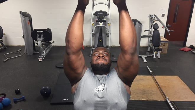 Matt Gono does pull-ups at Cinnaminson High School last week. The former Pirate is a potential NFL Draft pick.