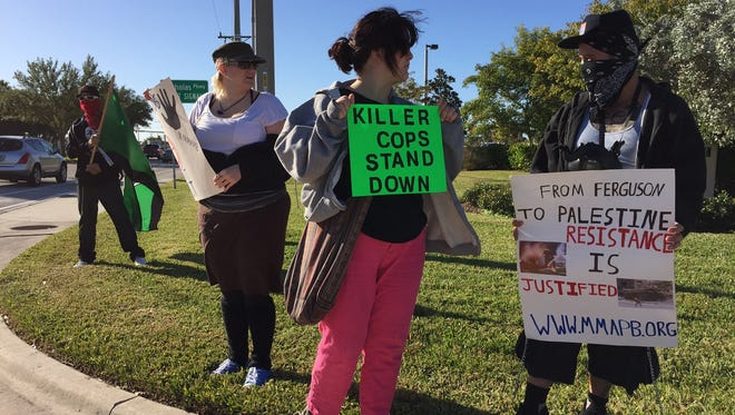 Members of South Florida Cop Block and Anonymous protest outside the Cape Coral Police Department.  They are protesting police brutality throughout the nation.