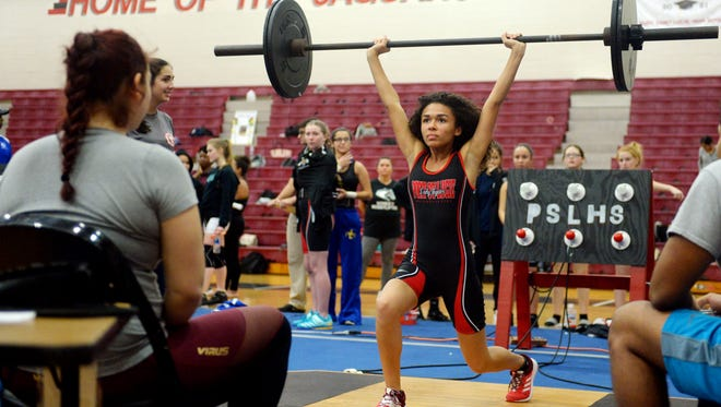Port St. Lucie High School's Alexandra Chisholm cleans 75 pounds in the 101-pound weight class on Friday, Jan. 12, 2018, during the District 16-1A girls' championship at Port St. Lucie High School.
