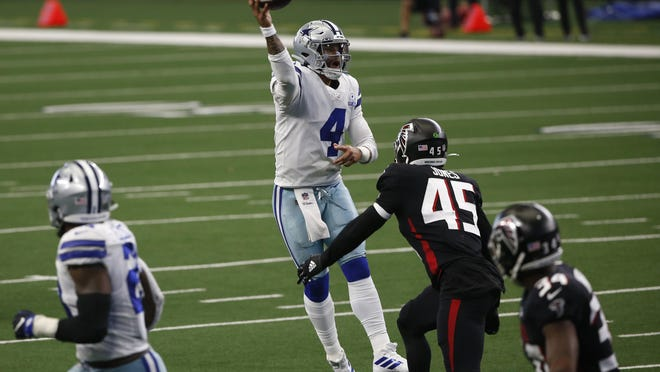 Dallas Cowboys quarterback Dak Prescott throws a pass under pressure from Atlanta Falcons linebacker Deion Jones during the Cowboys' 40-39 win last Sunday. Prescott's 450 yards passing last week was the third-highest total of his career.
