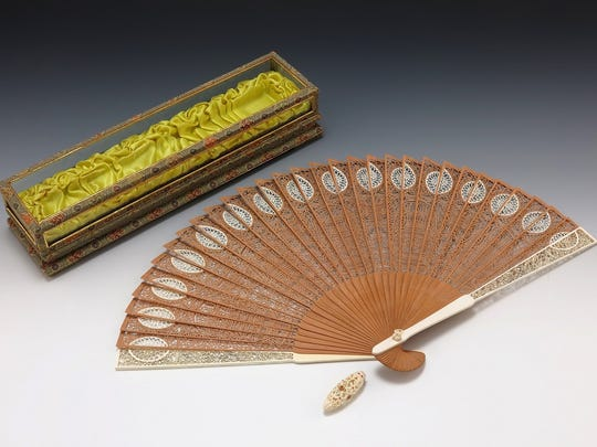 """A Chinese hand fan presented to former first lady Betty Ford by the People's Republic of China among more than 150 items making up the """"In Step with Betty Ford"""" exhibit."""