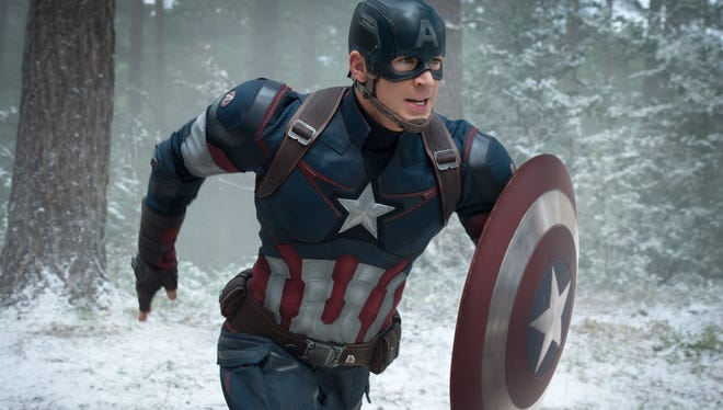 """Chris Evans as Captain America/Steve Rogers, in the new film, """"Avengers: Age Of Ultron."""" The movie releases in U.S. theaters on May 1, 2015."""