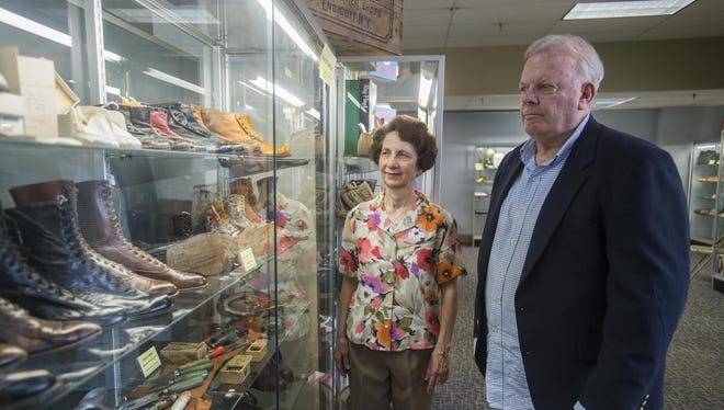 Marlene Yacos, director of the Endicott Heritage Center and Ted Warner, president of the Old Village of Union Historical Society, look at the new Endicott-Johnson Shoe exhibit on the second floor of the Heritage Center on July 8, 2015.