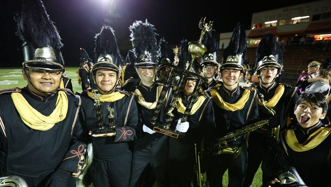 Members of the North Salem marching band celebrate winning the Pacific Coast Invitational at Sprague High School, Saturday, Oct. 3, 2015, in Salem, Ore.