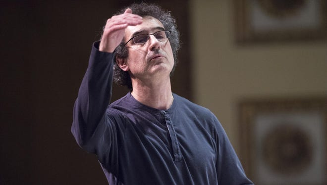 José-Luis Novo, then-music director of the Binghamton Philharmonic, conducts during a February rehearsal in Binghamton.