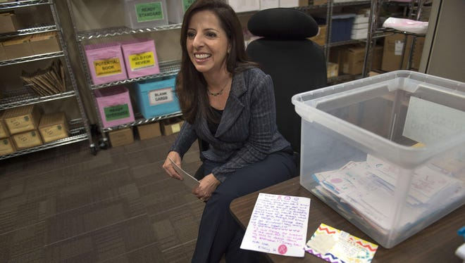 Gina L. Mulligan founded Girls Love Mail, based in Folsom, Calif., after being touched by encouraging notes from strangers when she battled breast cancer.