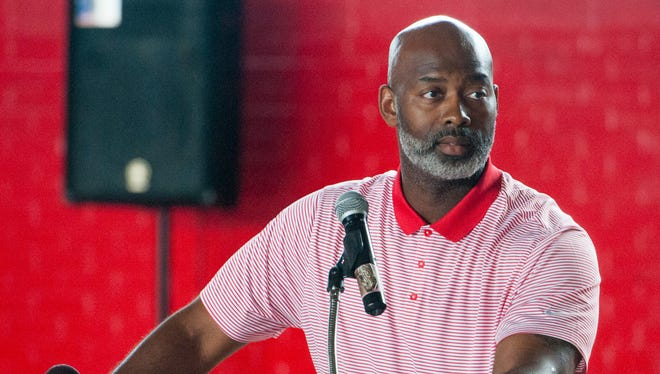 Lee High School athletic director Tyrone Rogers speaks as Rod Scott is remembered during a jersey retirement ceremony at Lee High School in Montgomery, Ala., on Thursday May 12, 2016.  Scott died on March 4 from injuries suffered in a car accident.