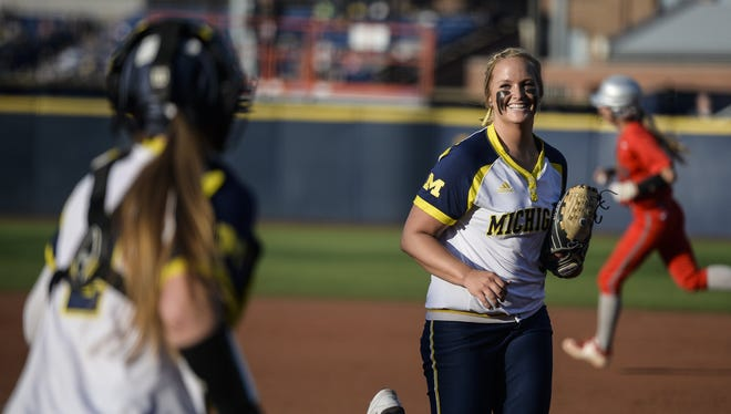 Michigan's Megan Betsa, front right, runs off the field after an inning during an NCAA college softball game against Ohio State, Friday, April 15, 2016, in Ann Arbor, Mich.