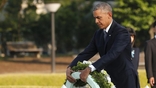U.S. President Barack Obama lays a wreath at Hiroshima Peace Memorial Park in Hiroshima, Japan, May 27. Obama became the first sitting U.S. president to visit the site of the world's first atomic bomb attack, bringing global attention both to survivors and to his unfulfilled vision of a world without nuclear weapons.