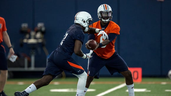 Jeremy Johnson hands off the ball to Kerryon Johnson during Auburn's first day of practice on Wednesday, Aug. 3, 2016 in Auburn, Ala.