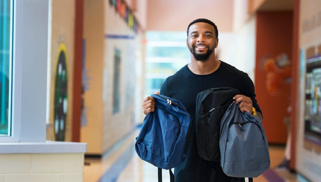 Former Clemson Quarterback Tajh Boyd donated 250 backpacks to children at Woodland Elementary School in Greer on Monday, August 15, 2016.