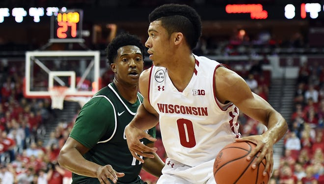 D'Mitrik Trice was a three-year starter in basketball and the starting quarterback in high school in Huber Heights, Ohio.