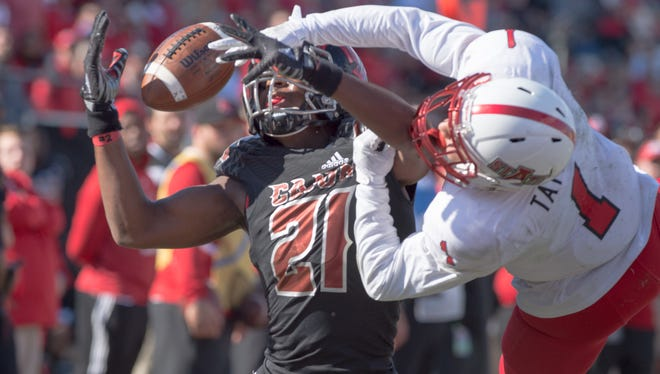 Cajuns wide receiver Keenan Barnes comes down with a pass under pressure during the Cajuns' win over Arkansas State on Saturday.