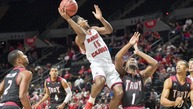 UL's PJ Hardy takes the ball to the basket during Saturday night's loss to Troy