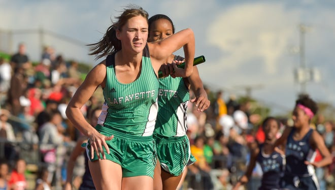 Mikaela Vanek takes the baton from Gentry Jacquet during a relay at the Oil City Relays last month at Lafayette High.