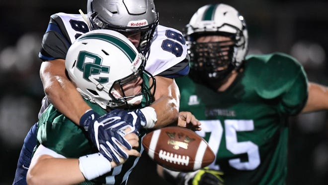 Reitz's Jacob Pace (88) wraps up Catholic quarterback Will Warren (14) for a sack as Evansville Reitz plays Owensboro Catholic in the second game of a double header at the Independence Bank Border Bowl played at Steele Stadium in Owensboro, August 25, 2017.