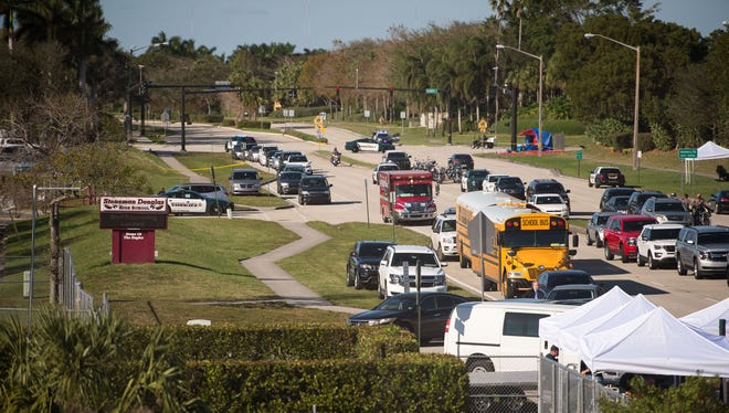 The view from Sawgrass Expressway in Parkland, Fla., toward the entrance to Marjory Stoneman Douglas High School on Feb. 15, 2018, a day after a former student killed 17 people and injured at least 14.