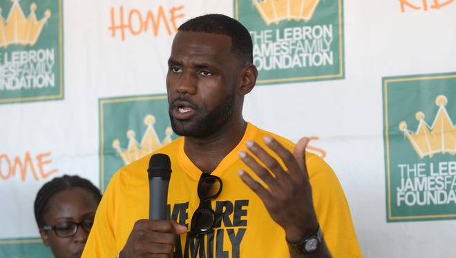 """LeBron James speaks with reporters following the LeBron James Family Foundation """"I Promise"""" reunion event Thursday, Aug, 13, 2015, at Cedar Point in Sandusky, Ohio."""