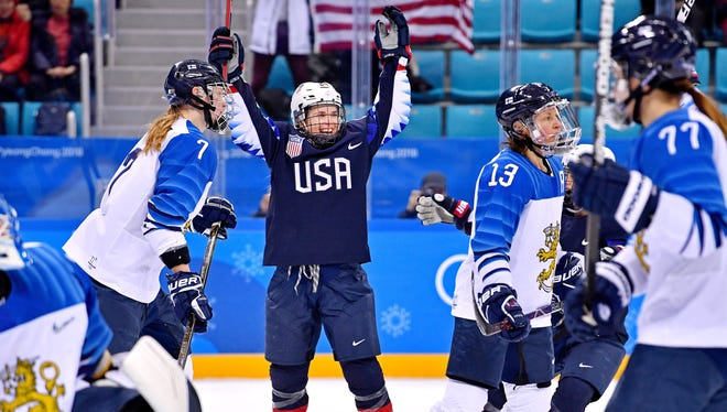 U.S. forward Danielle Cameranesi (24) celebrates a goal against Finland in the women's ice hockey semifinals.