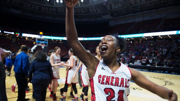 Wade Hampton's Bre Watts (24) celebrates after winning the Class AAAAA girls Upper State Championships at Bon Secours Wellness Arena on Saturday, February 24, 2018.