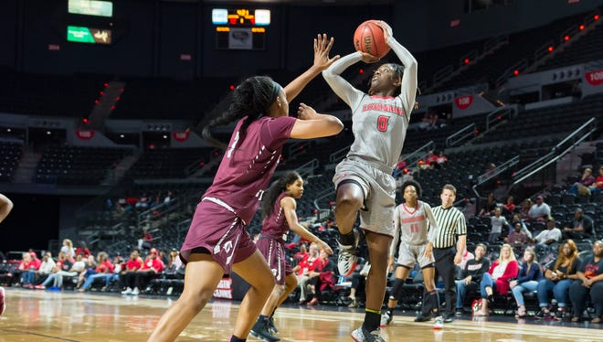 UL's Kendra Howard scores 13 points on Senior Night in the Cajuns' overtime loss to Little Rock on Saturday in the Cajundome.