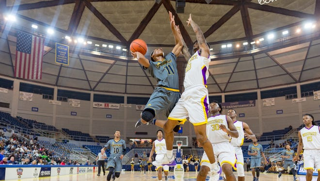 Nicholas Carmouche takes it to the basket as Carencro boys basketball face off against Westgate in the semi finals of the LHSAA State Tournament Tuesday.