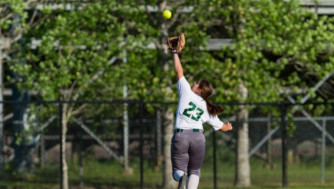 Jessi Daigle hauls in a fly ball as Beau Chene takes on Acadiana Softball. Tuesday, April 10, 2018.