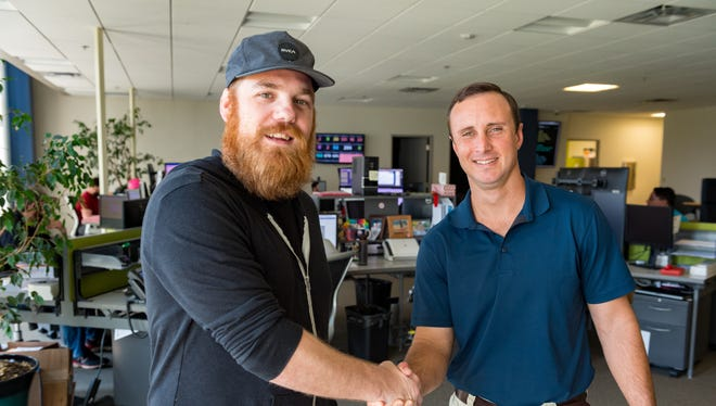 Singer Marc Broussard and Jacob Landry, president of Rader Solutions meet Thursday, May 17, 2018. Rader Solutions, an IT services company located in the LITE Center, is sponsoring Broussard's show at the South Louisiana Songwriters Festival and Workshop. In turn, the singer will perform for Rader's fundraiser for United Way later this year.