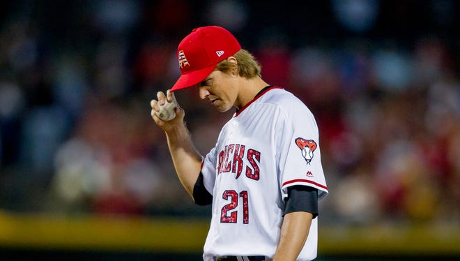 Arizona Diamondbacks starting pitcher Zack Greinke takes a moment to himself before pitching on July 3, 2018, during the Arizona Diamondback's matchup against the St. Louis Cardinals at Chase Field in Phoenix, Arizona.