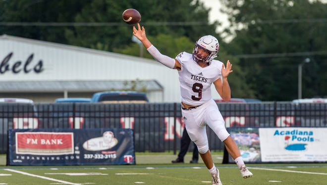 Tigers quarterback Cole Mouton throws a pass as the Teurlings Rebels take on Breaux Bridge. Friday, Aug. 31, 2018.