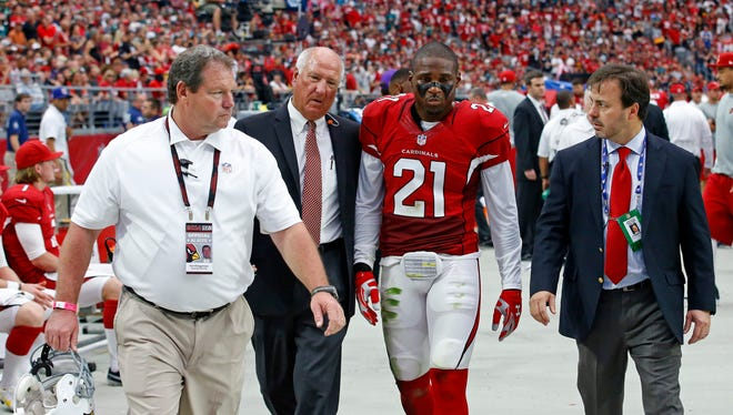 Arizona Cardinals cornerback Patrick Peterson (21) is walked to the locker room after being injured during the 2nd quarter against he Philadelphia Eagles in their NFL game Sunday, Oct. 26, 2014 in Glendale.