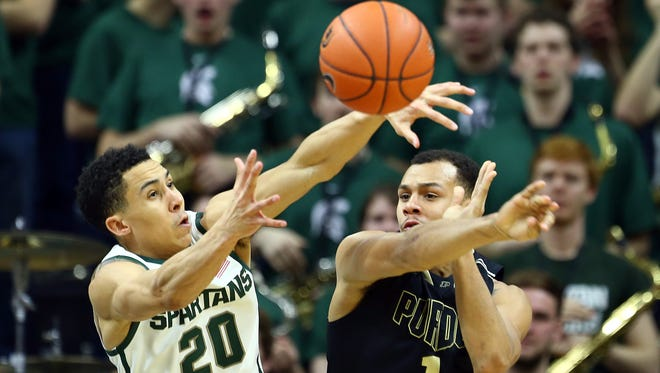 Michigan State Spartans guard Travis Trice (20) and Purdue Boilermakers guard Bryson Scott (1) battle for loose ball during the 2nd half of a game at Jack Breslin Student Events Center.