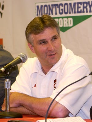 Dan Peters answers questions in June of 2004 during a press conference to announce his appointment as interim coach at UC.