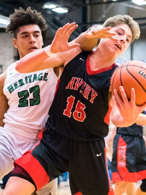 The Mountain Heritage boys basketball team played Avery County high school in the Western Highlands Conference tournament at Madison high school Friday, February 16, 2018.