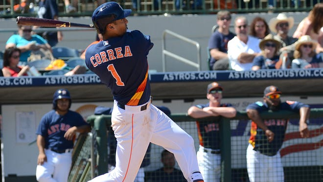 Houston Astros infielder Carlos Correa (1)  hits a two-run home run in the fifth inning   of the spring training game against the Atlanta Braves  at Osceola County Stadium.