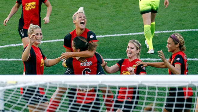 WNY midfielder Lianne Sanderson jumps on Abby Erceg after Erceg's goal earlier this season. The Flash take a 8-5-2 record into their final five matches and are in third place.