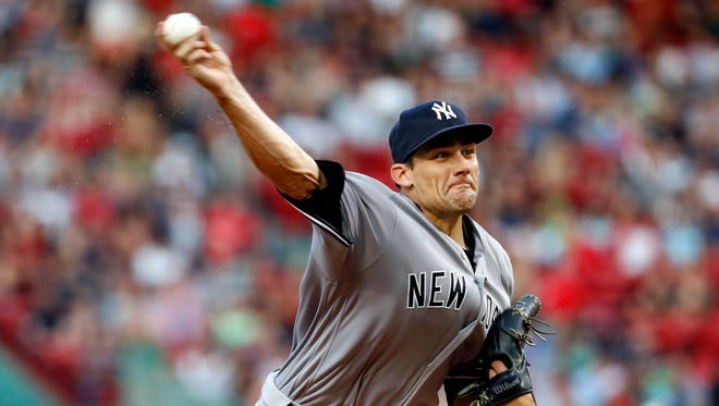 New York Yankees starting pitcher Nathan Eovaldi delivers a pitch against the Boston Red Sox during the first inning of a baseball game at Fenway Park in Boston Wednesday, Aug. 10, 2016.