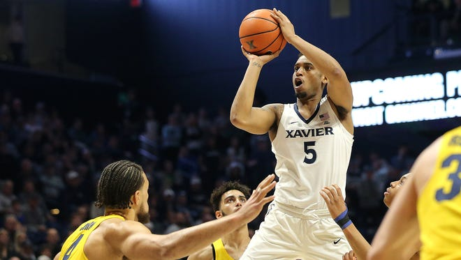 Xavier Musketeers guard Trevon Bluiett (5) shoots and scores his 2,000th career point in the second half during the NCAA basketball game between the Marquette Golden Eagles and the Xavier Musketeers,  Wednesday, Jan. 24, 2018, at Cintas Center in Cincinnati. Xavier won 89-70.