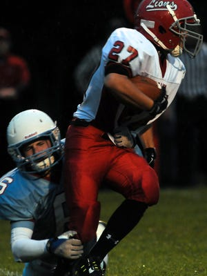 Southern Door's Tyler Malcore tackles Brillion's Graham Hasse. The Eagles held the Lions to 80 yards of total offense.