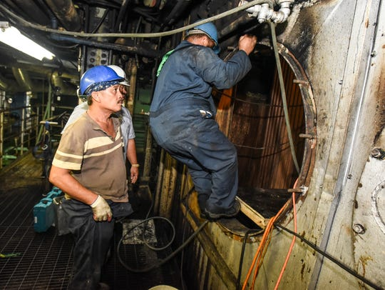 Guam Power Authority employees prepare to enter a boiler to continue work on steam boiler tubes at the Cabras Power Plant in Piti on Wednesday, Sept. 7, 2016. A new 180-megawatt power plant, to be built in Dededo, will allow the remaining Cabras generators to be retired, according to GPA.