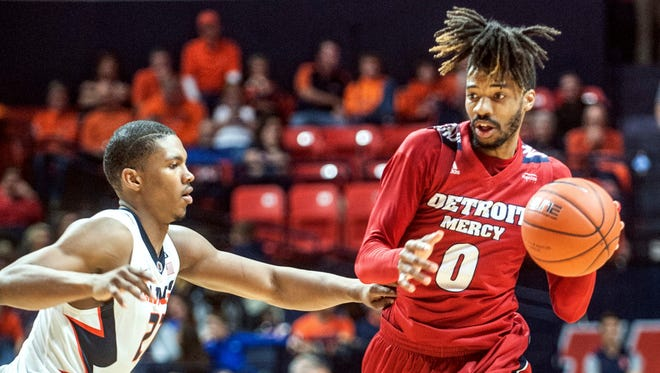Detroit Mercy guard Chris Jenkins (0) tries to drive against Illinois on Nov. 18, 2016.