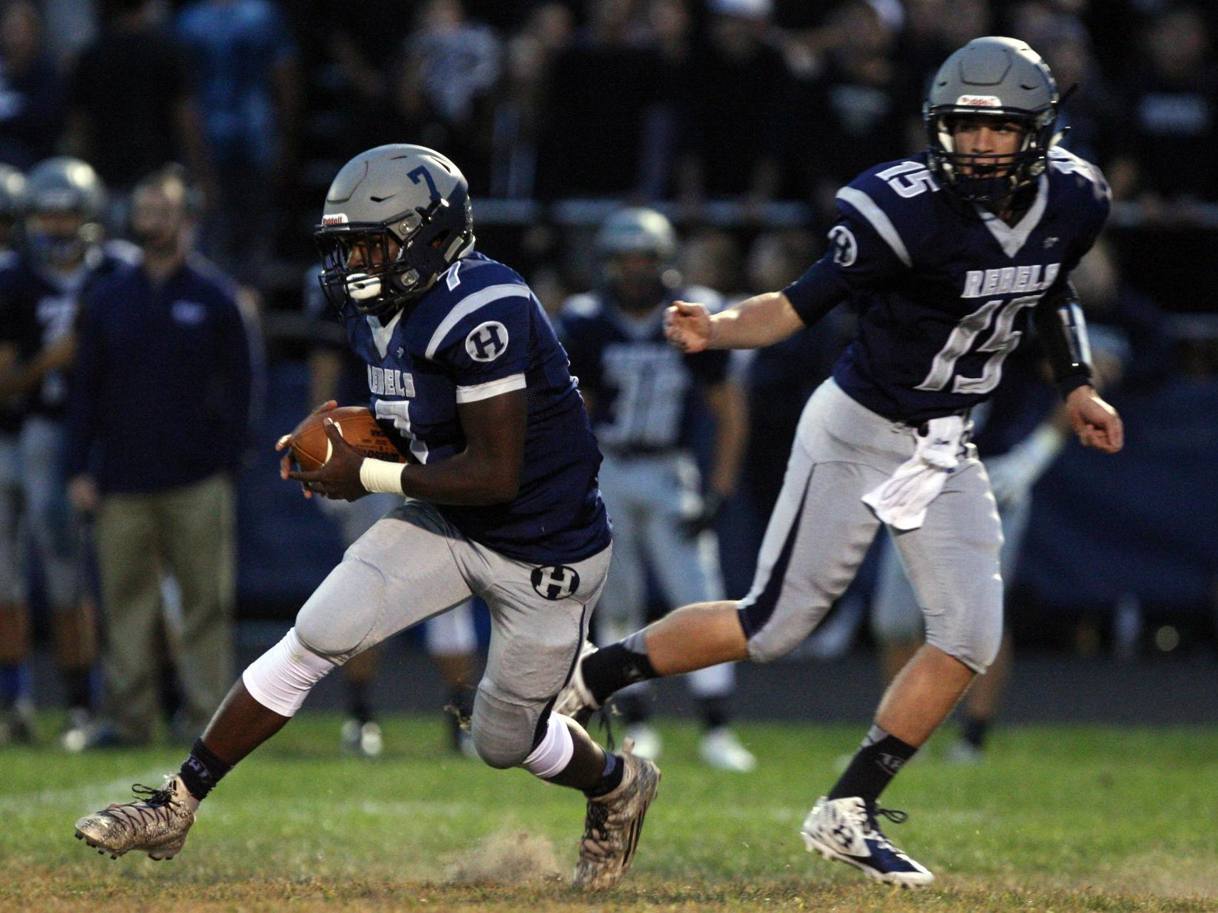 Mark Iacobino, #15 Howell, hands off to Mekai Gandy, #7, as they play Freehold Township in a football game Friday, September 25, 2015, at Howell High School.