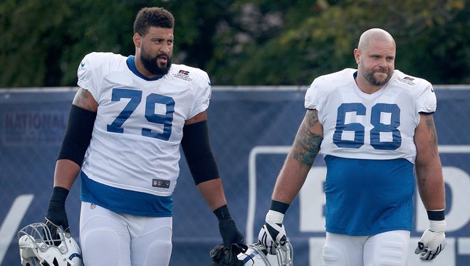 Indianapolis Colts offensive tackle Austin Howard (79) and offensive guard Matt Slauson (68) during their ninth day of training camp at Grand Park in Westfield on Sunday, August 5, 2018.
