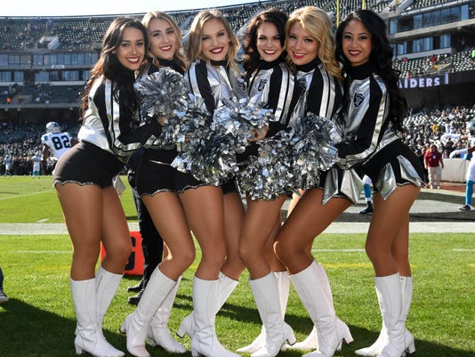 9047674bf USP NFL  CAROLINA PANTHERS AT OAKLAND RAIDERS S FBN USA CA. Oakland Raiders  raiderette cheerleaders pose during a NFL football game against ...