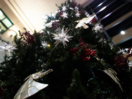 Stars and angels adorn the Christmas tree during the