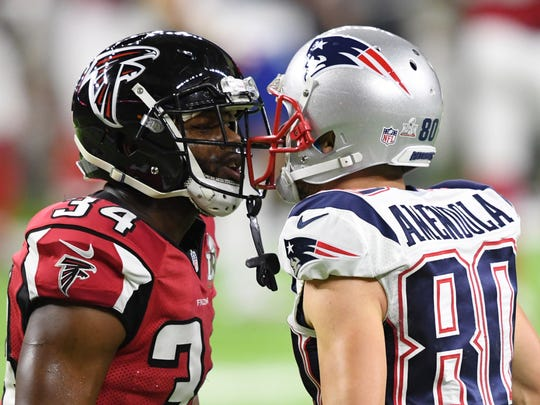 Falcons cornerback Brian Poole (34) and Patriots wide receiver Danny Amendola (80) exchange words during the second quarter during Super Bowl LI at NRG Stadium.