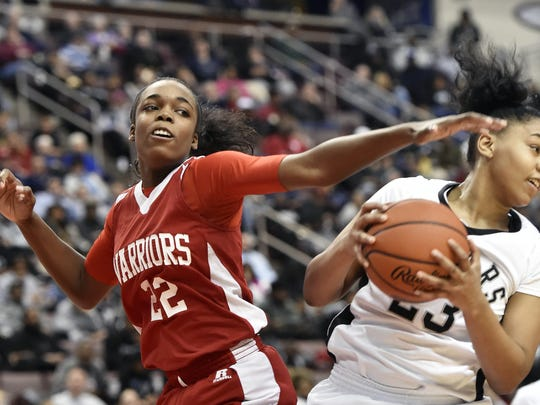 Susquehannock's Jaden Walker loses the rebound to Harrisburg's Dajahnae Brown in the second half of the PIAA District 3 Class 5A girls' basketball title game Saturday, March 4, 2017, at the Giant Center. Susquehannock defeated Harrisburg 44-42 to win its first district championship.